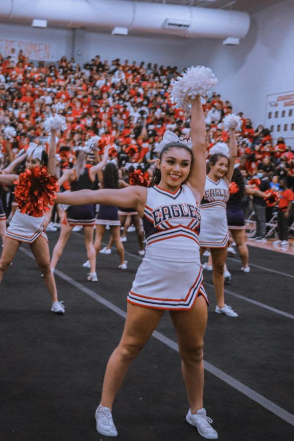 The cheerleaders performed in support of the football players. Both JV and varsity cheer performed.
