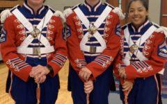 Maguire Emswiler (left), Mason Stump (center) and Marissa Estrada (right) are this years drum majors. Estrada is a senior trumpet player.