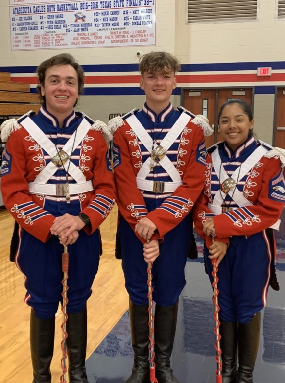 Maguire Emswiler (left), Mason Stump (center) and Marissa Estrada (right) are this years drum majors. Emswiler is a senior trumpet player.