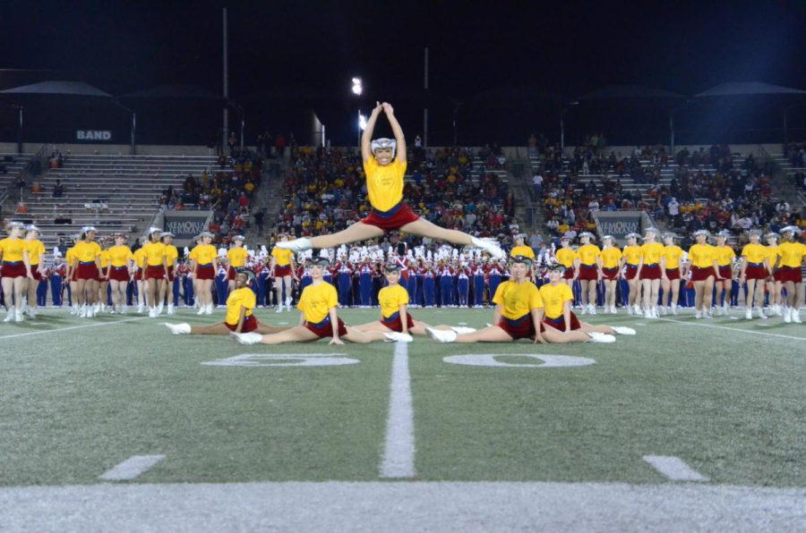 The+Patriettes+wore+Gold+Fight+Win+shirts+for+their+performance+at+the+game.+This+showed+their+support+for+pediatric+cancer+patients.